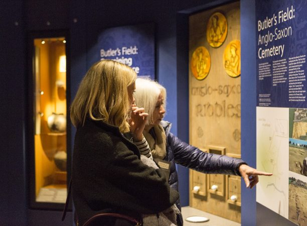 Two ladies looking at a museum display