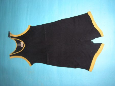 Men's bathing costume made of black knitted cotton with yellow trim, 1920s.