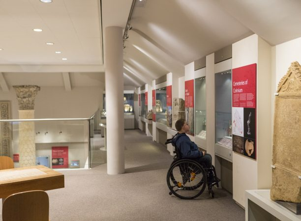 Man in wheelchair looking at exhibit