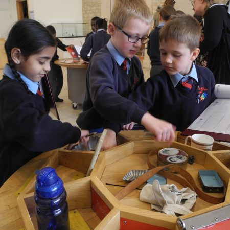 Children looking at artefacts