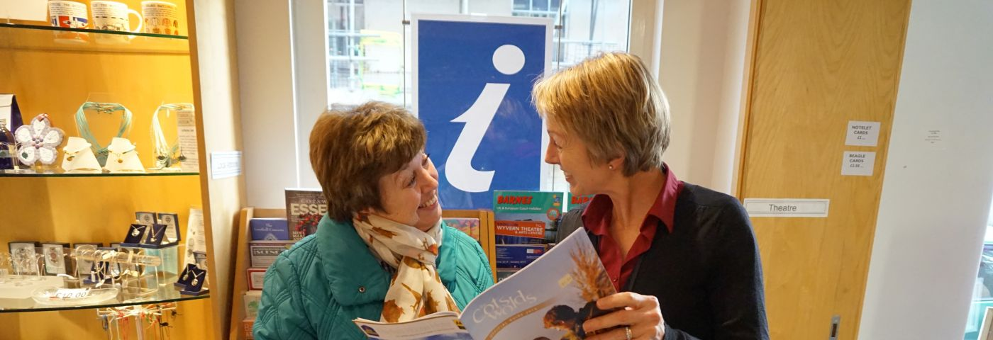 Two ladies talking in the visitor information centre
