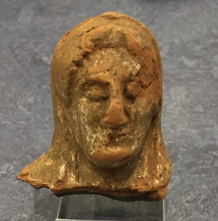 The terracotta figurine.